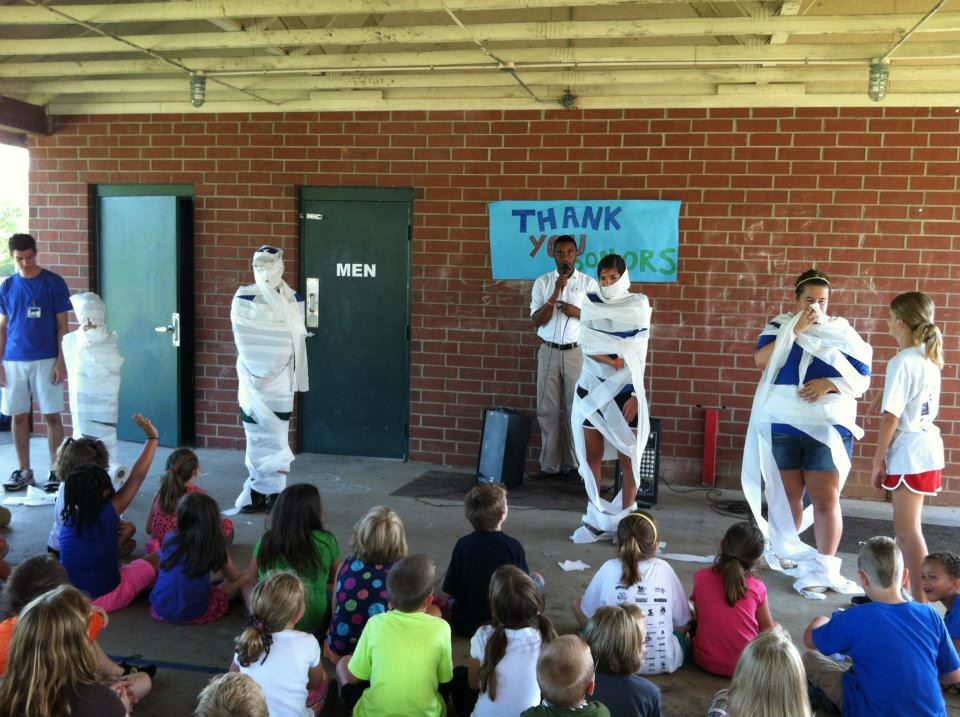 Roderick during opening assembly at his summer camp leading an activity in which campers mummified their counselors!